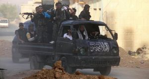 Free Syrian Army fighters on a pick-up tuck, head towards the frontline  in Damascus. Photograph: Ward Al-Keswani/Reuters
