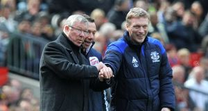 Manchester United manager Alex Ferguson and Everton boss  David Moyes share a laugh on the touchline as opponents. The latter is now in line to succeed the fomrer at Old Trafford.  Photograph: Martin Rickett/PA Wire.