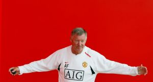 Alex Ferguson gestures before a photocall at the club's Carrington training complex in Manchester. Ferguson is to retire at the end of the season.