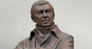 A statue of retiring Manchester United Alex Ferguson outside Old Trafford. Photograph: Nigel Roddis/Reuters