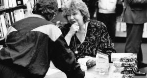 Time for the reader: Maeve Binchy signs books in 1991. Photograph: Frank Miller