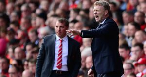 David Moyes gestures as Liverpool Manager Brendan Rodgers looks on during the  League match between Liverpool and Everton at Anfield in May. Photograph: Laurence Griffiths/Getty Images
