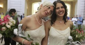 "Amber Weiss and Sharon Papo walk through City Hall in San Francisco after exchanging wedding vows on the first full day of legal same-sex marriages there in 2008. ""Abortion, euthanasia, homosexual marriage – all these have in common that they represent a repudiation of existing understandings and belief systems."" Photograph: Erin Siegal/Reuters"
