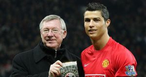 Cristiano Ronaldo with former manager Alex Ferguson at Manchester United. The Real Madrid striker has admitted he misses United but it is not yet clear how Ferguson's departure will affect his view.