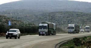 A convoy formed by a delegation of the United Nations High Commissioner for Refugees and the Syrian Arab Red Crescent carry humanitarian aid as they drive in Aleppo's countryside. Photograph: Reuters