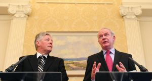 Peter Robinson and Martin McGuinness have set a target of 2023 to bring down all of Northern Ireland's 60 so-called peace walls.