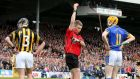 Referee Barry Kelly shows JJ Delaney of Kilkenny and Lar Corbett of Tipperary a red card each during the league final. Photograph: Cathal Noonan/Inpho