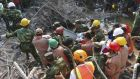 Rescuers carry Reshma Begum, pulled out from the rubble of a building that collapsed in Saver, near Dhaka in Bangladesh yesterday. Photograph: AP Photo/Parvez Ahmad Rony