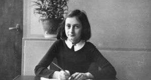 Anne Frank, aged 12, in 1940, before she and her family were forced into hiding in Amsterdam. Photograph: Anne Frank House, Amsterdam