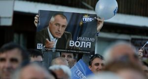 A supporter of Bulgaria's centre-right Gerb party holds a poster of party leader Boiko Borisov during an election rally in the city of Veliko Tarnovo yesterday. Photograph: Reuters/Stoyan Nenov