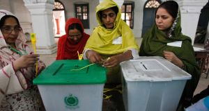 An election official seals a ballot box before the start of voting at a polling station in Rawalpindi. Photograph: Mian Khursheed/Reuters