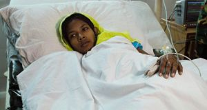 Reshma Begum (19) rescued from the rubble of the Rana Plaza building 17 days after the building collapsed, lies on a bed at Savar Combined Military Hospital in Savar. Photograph: Andrew Biraj/Reuters