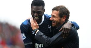 Emmanuel Adebayor is congratulated by Spurs manager Andre Villas-Boas after scoring the winning goal against Stoke City  in the   Premier League match   at the Britannia Stadium. Photograph: Laurence Griffiths/Getty Images
