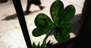A shamrock in the window of an Irish pub in New York. The Irish diaspora is of the order of 70 million and rising. Photograph: Spencer Platt/Getty Images