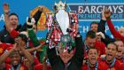 Manchester United manager Alex Ferguson lifts the English Premier League trophy at Old Trafford after his side  beat Swansea in   his last home game as manager. Photograph:  Phil Noble/Reuters