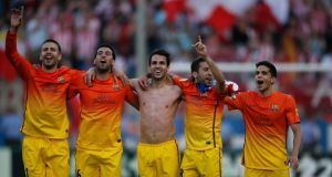 Barcelona's  Gerard Pique, Sergio Busquets, Cesc Fabregas, Jordi Alba and Marc Bartra celebrate at the end of their match against Atletico Madrid at Vicente Calderon stadium in Madrid on Sunday. Photograph: Reuters