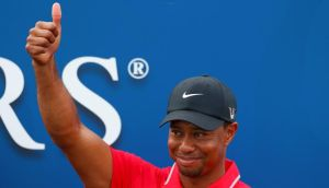 Tiger Woods after being presented with the Players Championship trophy at Sawgrass in Florida last night. Photograph: Chris Keane/Reuters