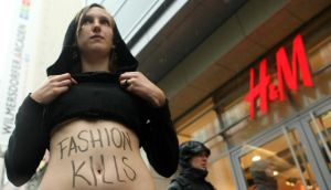 An activist protests against working conditions at production sites used by the H&M clothing chain in Bangladesh in Berlin last summer. Photograph: Getty Images