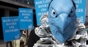 A protester, dressed to look like the Barclays Bank logo, demonstrates outside the bank's annual general meeting for shareholders  in central London recently. Photograph: Alastair Grant/AP