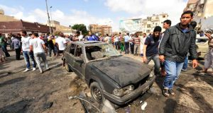 People gather at the scene of a car bomb explosion outside a hospital in Benghazi. Photograph: Esam Al-Fetori /Reuters