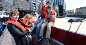 Ruth O'Connor with Sam Kinsella and children Lúí (5) and Rohan (22 months), on board Scéal Eile, during their barge trip on the Grand Canal, Dublin. Photographs: Dara Mac Dónaill
