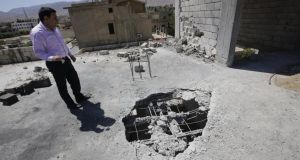 A Lebanese man inspects the damage after a rocket coming from Syria fell on his house in the town of Hermel, a few kilometres from Baalbek in the Bekaa valley, on April 26th, 2013. Photograph: AFP/Getty