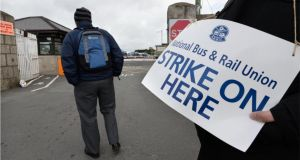 National Bus & Rail Union, (NBRU) members picket the Bus Eireann depot in Broadstone, Dublin today.  Photograph: Dara Mac Dónaill / The Irish Times