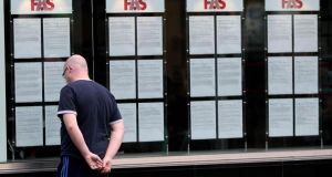 "A man looks in the window at a FAS employment centre in Dublin. The  National Economic and Social Council has said that ""arguably the biggest blight of the economic crisis, affecting people's income, their well-being and the overall economy"" .  It found that under 25s, those with low levels of education, and non-Irish nationals were much more likely to be unemployed than the national average.   . It also found that, while just 4,100 were under-employed in 2006 that figure rose to 145,800 in 2012, an increase of 3,456 per cent.  Photograph: Niall Carson/PA Wire"