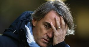 "Roberto Mancini:    A statement on the club's website read: ""It is with regret that Manchester City Football Club announces that Roberto Mancini has been relieved of his duties as Manchester City manager."" Photograph: Getty Images."