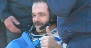 Canadian astronaut Chris Hadfield gives a thumbs-up after a successful parachute landing in Kazakhstan. Photograph: Nasa handout/Reuters