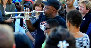 Kenneth Terry with the Treme Brass Band plays the trumpet on the corner of North Villere and Frenchman Street during a community response to the shooting. Photograph: Sean Gardner/Getty Images
