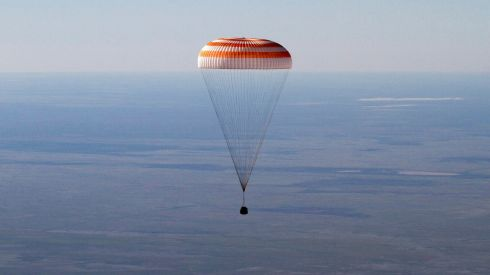 The Russian Soyuz space capsule, carrying US astronaut Tom Marshburn, Russian cosmonaut Roman Romanenko and Canadian astronaut Chris Hadfield, descends some 150 km southeast of the town of Zhezkazgan, in central Kazakhstan today. Photograph: Reuters