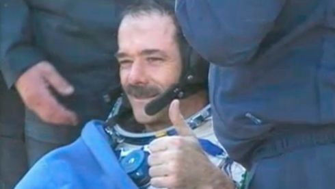 Canadian astronaut Chris Hadfield gives a thumbs-up after a successful parachute landing in Kazakhstan today. Photograph: Reuters