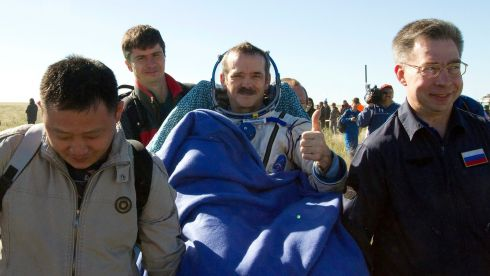 Ground personnel carry Canadian astronaut Chris Hadfield after his landing today. Photograph: Reuters