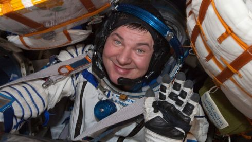 Russian cosmonaut Roman Romanenko looks out from the Russian Soyuz space capsule after its landing. Photograph: Reuters