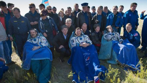 US astronaut Tom Marshburn (R), Russian cosmonaut Roman Romanenko (C) and Canadian astronaut Chris Hadfield sit after leaving the Russian Soyuz space capsule  today. Photograph: Carla Cioffi, NASA/Handout via Reuters