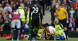 Chelsea's John Terry receiving treatment on an ankle injury during the game against  Aston Villa at Villa Park. Photograph: Philip Brown/Reuters
