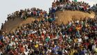 "Miners gather at a hill dubbed the ""Hill of Horror"" during a memorial service for miners killed during clashes at Lonmin's Marikana platinum mine in Rustenburg, last August. Photograph: Siphiwe Sibeko/Reuters"