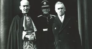 "Archbishop John Charles McQuaid with then taoiseach John A Costello and (standing behind) Costello's ADC, Mick Byrne. Costello told the Dáil: ""I, as a Catholic, obey my church authorities and will continue to do so . . . There will be no flouting of the authority of the bishops in the matter of Catholic social or moral teaching."""
