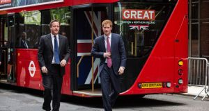 Britain's Prince Harry and British Prime Minister David Cameron (L) arrive  to meet entrepreneurs using London's new double-decker Routemaster bus, in Manhattan. Photograph: Reuters/Brendan McDermid