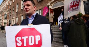 Paul O'Hare and fellow protestors gathered outside the Allsop property auction at the Shelbourne Hotel Dublin today  Photograph: Bryan O'Brien / The Irish Times