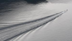 The angle at the apex of the wake of a boat is fixed at about 40 degrees, irrespective of a boat's speed. This pattern is called a Kelvin wake. Photograph: Getty Images