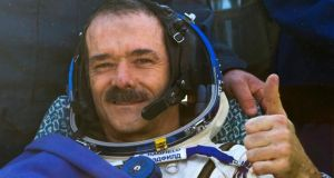 Canadian astronaut Chris Hadfield give a thumbs up after the Russian Soyuz space capsule landed some 150 km southeast of the town of Zhezkazgan in central Kazakhsta. Photograph: Reuters
