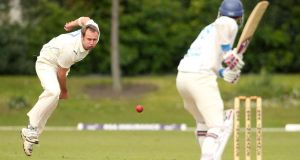 North West Warriors' Peter Connell bowls to Leinster Lightning's Alex Cusack during day two of the RSA Inter-Provincial Championship match at College Park in Dublin. Photograph: Kieran Murray/Inpho