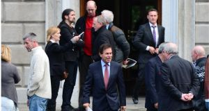 Minister for Justice Alan Shatter walks past Independent TD Luke Ming Flanagan before speaking to the media yesterday.
