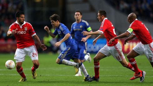 Chelsea's Oscar (centre) runs at the Benfica defence after kick-off at the Amsterdam ArenA. Photograph: Nick Potts/PA Wire.