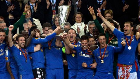 Injured John Terry front and centre as Chelsea players celebrate with the trophy.  Photograph: Dylan Martinez/Reuters