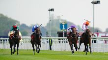 William Buick riding Libertarian (right) win The Betfred Dante Stakes at York. Photograph: Alan Crowhurst/Getty Images
