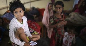 Children gather in a shelter house before cyclone Mahasen approaches in Chittagong on May 16th, 2013. Photograph: Reuters