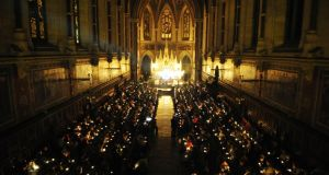 "People hold candles at the annual Console ""service of light"" in St Patrick's Chapel,  Maynooth College, last December, to remember those who have died by suicide. Photograph: Aidan Crawley"